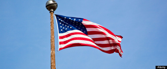 Brilliant American flag flying atop the pole on the Delaney Park Strip in Anchorage, Alaska on July 4, 2009 against a bright