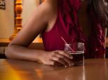 woman alone at bar