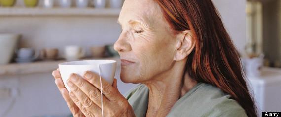 Senior woman enjoying green tea