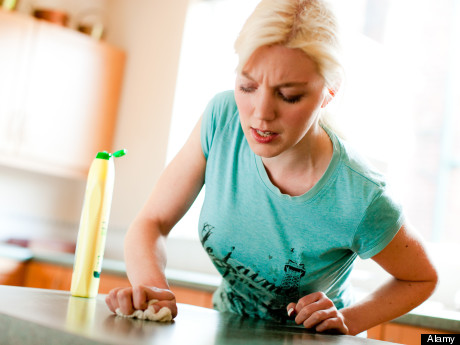 Woman cleaning worktop