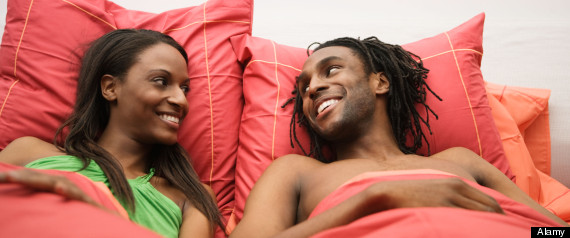 African couple laying in bed