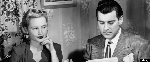 1940s COUPLE BREAKFAST TABLE IMPATIENT WOMAN LOOKING AT MAN READING NEWSPAPER