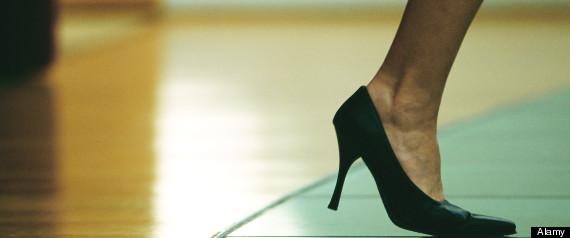 Woman walking in high heels, cropped view of foot