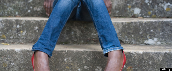 Close up of woman's pants and high heeled shoes
