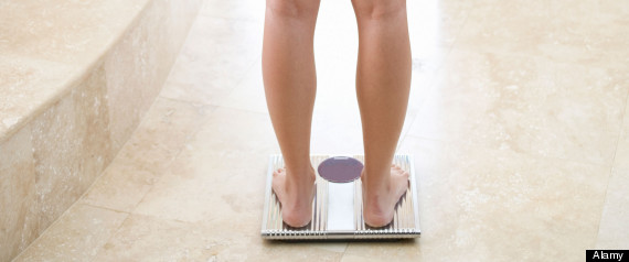 A woman standing on bathroom scales