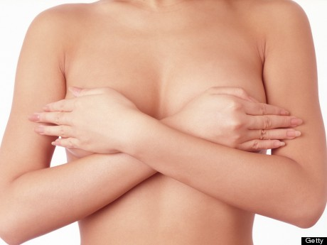 m-WOMAN-COVERING-BREASTS-460x345
